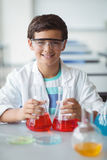 Portrait of schoolboy doing a chemical experiment in laboratory. At school Royalty Free Stock Images