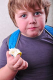Portrait of schoolboy eating apple Royalty Free Stock Image