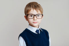 Portrait of schoolboy with glasses on white background Royalty Free Stock Photography