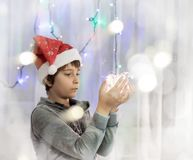Schoolboy with lights in his hands. Portrait of a schoolboy with lights in his hands Royalty Free Stock Photo