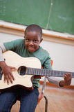 Portrait of a schoolboy playing the guitar Royalty Free Stock Photography