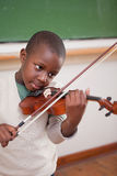 Portrait of a schoolboy playing the violin Stock Photo