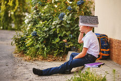 Portrait of a schoolboy on the street with a backpack and notebooks Royalty Free Stock Photos