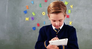 Schoolboy using digital tablet in classroom stock video footage