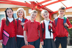 Portrait Of Schoolchildren Outside Classroom Carrying Bags royalty free stock photo