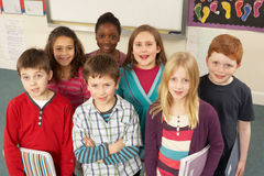 Portrait Of Schoolchildren Standing In Classroom Stock Photos