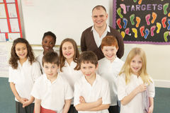 Portrait Of Schoolchildren Standing In Classroom royalty free stock photo