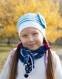 Portrait of a schoolgirl autumn day. Portrait of a schoolgirl solnechnm autumn day in the park Royalty Free Stock Image