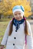 Portrait of a schoolgirl autumn day. Portrait of a schoolgirl solnechnm autumn day in the park Royalty Free Stock Photos
