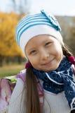 Portrait of a schoolgirl autumn day. Portrait of a schoolgirl solnechnm autumn day in the park Royalty Free Stock Images