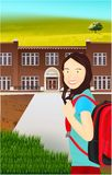 Portrait of schoolgirl with a backpack in nature stock image