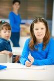 Portrait of schoolgirl in class Stock Image