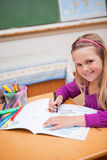 Portrait of a schoolgirl drawing Royalty Free Stock Photography