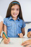 Portrait of schoolgirl drawing in book Royalty Free Stock Photos