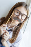 Portrait of a schoolgirl in funny glasses Royalty Free Stock Photo
