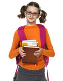 Portrait of schoolgirl in glasses. School girl with books on the white background stock photography