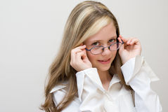 Portrait of the schoolgirl in glasses Royalty Free Stock Image