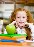 Portrait of schoolgirl looking at camera with smile Royalty Free Stock Image