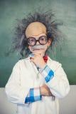 Portrait of schoolgirl pretending to be a teacher in classroom. At school Royalty Free Stock Image