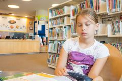 Girl in a Library Royalty Free Stock Images
