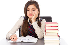 Portrait of a schoolgirl reading at desk Royalty Free Stock Photo