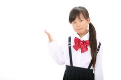 Portrait of schoolgirl showing Royalty Free Stock Photos