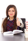 Portrait of a schoolgirl sitting at her desk with an open book a Stock Images