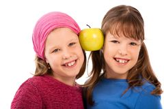 Portrait of schoolgirls with apple Stock Photos
