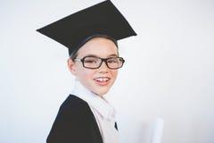 Portrait of schoolkid pretending to be graduate Stock Photo