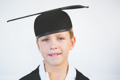 Portrait of schoolkid pretending to be graduate Royalty Free Stock Photo