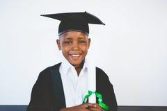 Portrait of schoolkid pretending to be graduate Stock Image