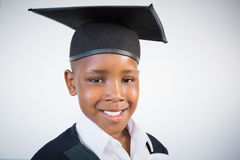 Portrait of schoolkid pretending to be graduate Royalty Free Stock Images