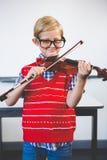 Portrait of schoolkid pretending to be music teacher Royalty Free Stock Photos