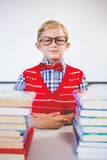 Portrait of schoolkid pretending to be a teacher in classroom Stock Image