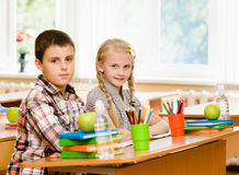 Portrait of schoolkids looking at camera at workplace Stock Images