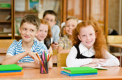 Portrait of schoolkids looking at camera at workplace Stock Image