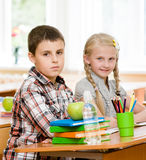 Portrait of schoolkids looking at camera at workplace Royalty Free Stock Images