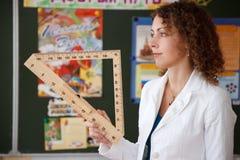 Portrait of schoolteacher in blouse in school royalty free stock photos