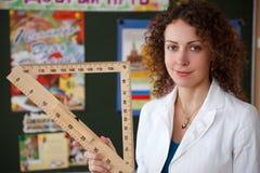 Portrait of schoolteacher in blouse in school stock photos