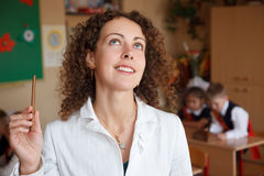Portrait of schoolteacher in blouse in school Royalty Free Stock Images