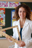 Portrait of schoolteacher in blouse in school Stock Photo