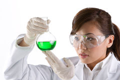 Portrait of a scientist analyzing a solution. Stock Photos