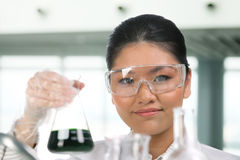Portrait of scientist analyzing a solution. Stock Images