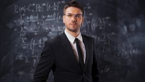 Portrait of scientist man standing near mathematical equations. Portrait of scientist man standing near mathematical formula, equations. He put on his stock video