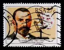 Portrait of Scientist - Sir Arnold Theiler, serie, circa 1991. MOSCOW, RUSSIA - OCTOBER 1, 2017: A stamp printed in South Africa shows portrait of Scientist royalty free stock photo