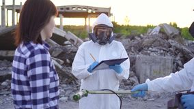 Portrait scientists in protective suits and masks and dosimeter ,measure personal ionizing radiation dosimeter and