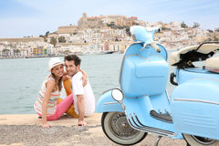 Portrait of scooter and cheerful couple relaxing by the sea Royalty Free Stock Photography