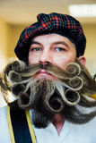 Portrait of a Scotsman man with a large beautiful beard curly. A mad beard from a barbershop. Stock Photo