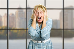 Portrait of screaming desperate woman. Stock Image