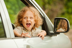 Portrait of a screaming little boy. Who sitting in the car Stock Photo